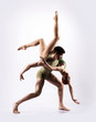 Couple of gymnasts on a light grey background