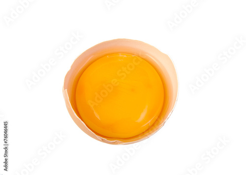 Leinwanddruck Bild Yolk in broken egg isolated on white background.