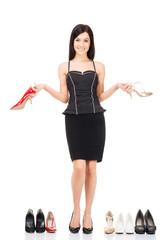 Beautiful girl choosing footwear over grey background