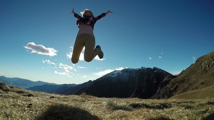 Woman jumping at top of mountain-Slow motion