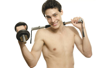 Skinny man training bicep muscle. Teenager lifting a dumbbell