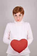 Woman holding a plush red heart on Valentine's day