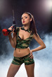 Concept photo. Sexy brunette armed with drill