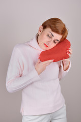 Woman with plush red heart  on Valentine's day