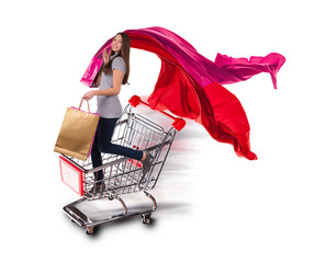 Young woman in basket, concept of shopping on white background