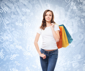 A young, attractive and happy shopping girl with bright shopping