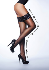 Beautiful legs in nice stockings on a light background