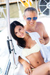 Man and a beautiful and sexy woman in a swimsuit on a boat