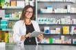 Leinwandbild Motiv Beautiful Pharmacist with Digital Tablet in a Drugstore