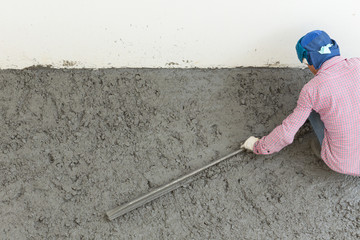 plasterer concrete cement worker plastering flooring of house co
