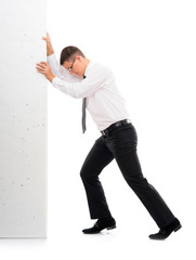 Young businessman pushing a blank board on white background