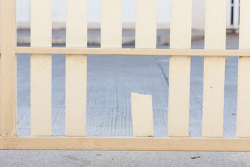 white wood fence of broken damaged