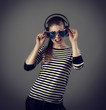 Funny picture of clubbing girl wearing headphones and eyeglasses