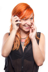 Pretty redhead girl laughing into the mobile