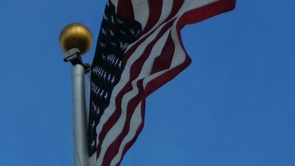 close up of american flag flying in wind