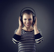Conceptual shoot of woman enjoying sound from earphones