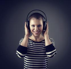 Conceptual shoot of woman enjoying sound from earphones