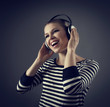 Portrait of beautiful female performer in headset singing song
