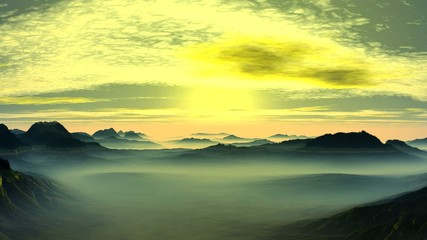 Bright sunrise in the misty mountain valley