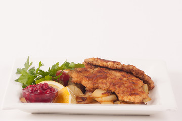 Wiener Schnitzel with rost potatoes and cranberry