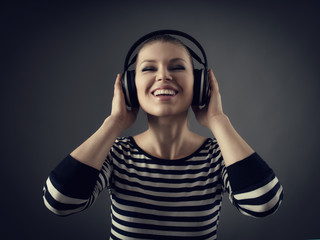 Concept of woman in headphones. Female musician looking excited