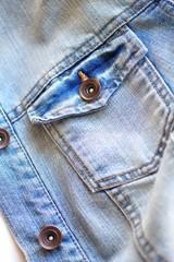 Light blue jeans jacket close up