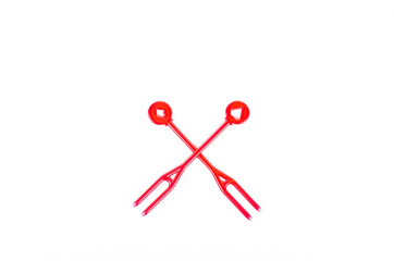 red plastic food skewer on white background