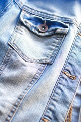 Light blue jeans jacket close up