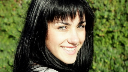closeup of woman looking camera smiling