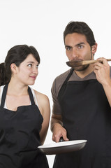 young attractive couple chefs wearing black apron
