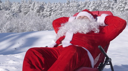 Santa Claus relaxing in a snowy forest at winter ski resort