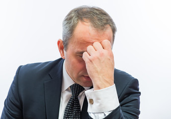 Frustrated businessman holding head in his hands