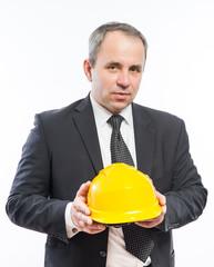 engineer or worker hand holding yellow helmet