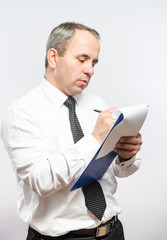 Businessman  with clipboard in his hand