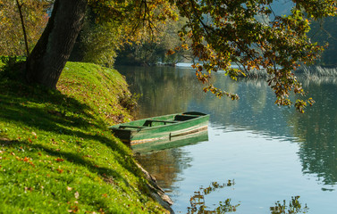 Lonely boat by Krka river, Otocec, Slovenia