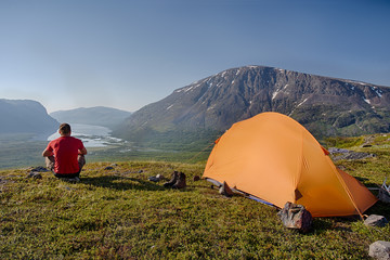 Hiker and tent in Lapland - Sweden