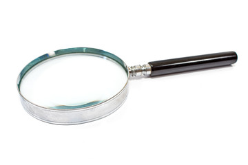 Antique magnifying glass isolated on white