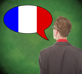 Young business man speaking french on school board background