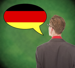 Young business man speaking german on school board background