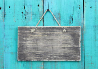 Blank wood sign on teal blue wooden background