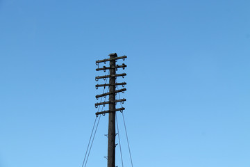 A Vintage Wooden Pole for Holding Telephone Wires.