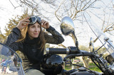 Biker woman looking at mirror
