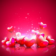 Heart shaped balloons on red background