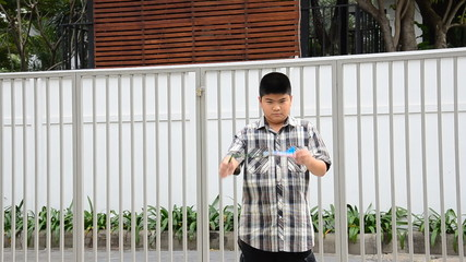 Asia young boy is playing plane in park. HD