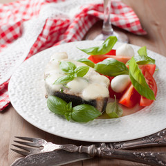fish baked with mozzarella and salad caprese