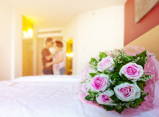 beautiful roses flowers bouquet on white bed and blur sweet love