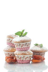 sweet muffins with dried apricots and sugar