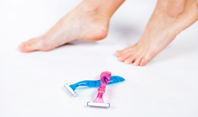 Woman's foot and razors shaving concept
