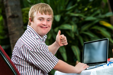 Handicapped student working on laptop.