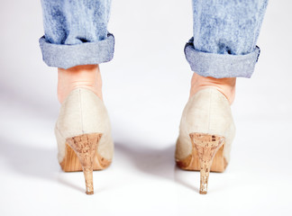 Close up of high heels and jeans